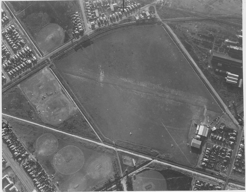 In this undated aerial photograph of Newcastle Aerodrome at Broadmeadow (present day site of Hunter Stadium) you can see the faint outline of where the New Lambton Railway used to run.
