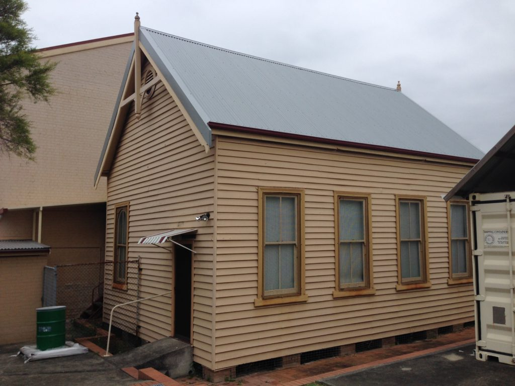 """The """"Institute Hall"""", the old weatherboard building that was relocated from Howe St to Elder St in August 1903."""